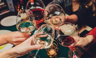 clinking-glasses-with-alcohol-toasting_152904-11