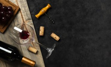 top-view-glass-wine-with-slate-background_23-2148243148